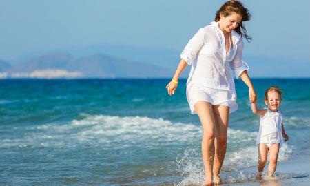beach-walking-mother-child