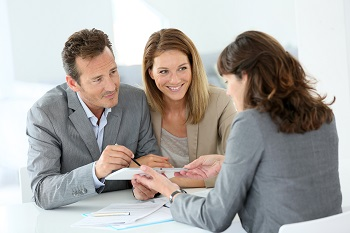 couple with banker for home loan pre-approval