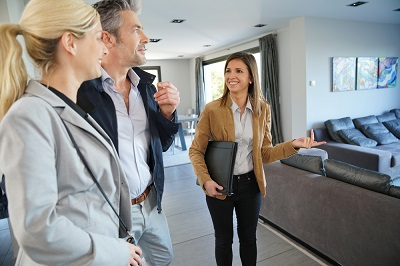 real estate agent showing a home