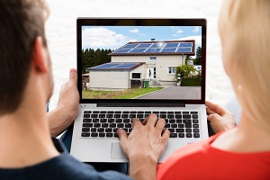 homebuyers looking at home on laptop